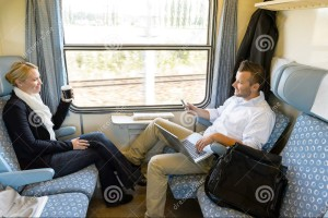 http://www.dreamstime.com/stock-images-man-woman-sitting-train-talking-image28147584