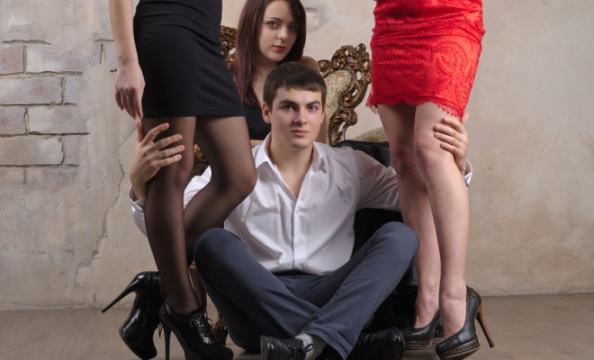 Portrait of three women and one guy posing in a close up shot